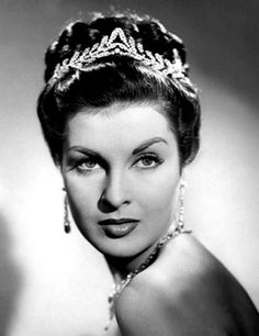 Breath-taking beauty, Italian actress (and the 1946 winner of Miss Italy) Silvana Pampanini looking radiant in a tiara and lashings of jewels.