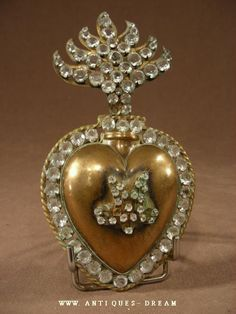 Antique sacred heart...have some like this & even more beautiful in person
