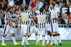 Juventus players celebrate a goal by Fernando Llorente during the...