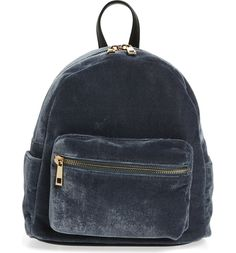 Trimmed in supple faux leather, this pretty little backpack is the perfect way to add a dash of luxe to any ensemble.