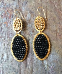 A personal favorite from my Etsy shop https://www.etsy.com/listing/218626529/gold-hoop-earrings-with-gold-beads-and