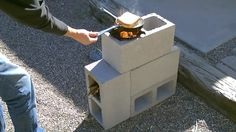 "The ""4 Block"" Rocket Stove! - DIY Rocket Stove - (Concrete/Cinder Block ...How to make a ""FOUR BLOCK"" Rocket Stove! Easy DIY. Four concrete blocks is all it takes to make it!. Cost $5.16. video shows you how to put it together. the stove funnels all its heat up under the bottom of the pan. uses very little fuel. fueled by small sticks, twigs and leaves. cooks great. wind and rain resistant)"