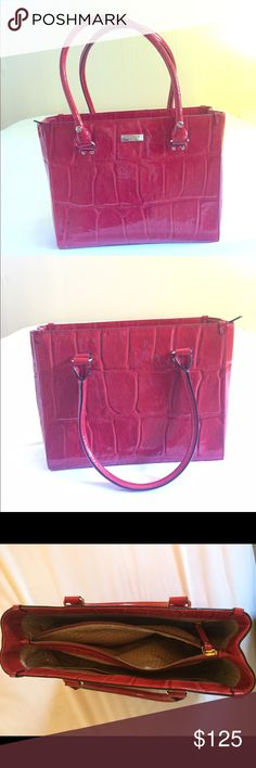 Fabulous Kate Spade Red Croc Embossed Leather Tote Fabulous Kate Spade Red Crocodile Embossed Leather Tote- great condition! Authentic bag. Inner zipper pouch as well as 2 open pockets and 1 zipper pocket. Shiny beige patterned interior. Excellent condition- preowned but rarely used! kate spade Bags Totes