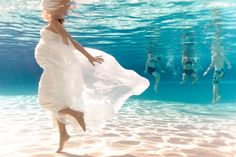 Underwater maternity photoshoot by Ben Hung. Pregnant baby white