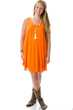 Stand out in the stands this football season in this orange dress! Perfect for a Clemson or Auburn Gameday.