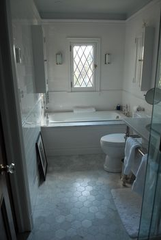 Tub is Porcher cast iron, Toto mercer toilet, Gramercy wash stand