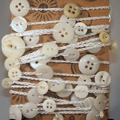 Hey, I found this really awesome Etsy listing at http://www.etsy.com/listing/104660215/crocheted-vintage-button-garland
