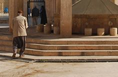 A man on his way to wash before going into the mosque. Sanliurfa, Turkey