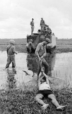 Vietnamese Soldiers Torture A Viet Cong Guerrilla