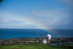 Family looking at the beautiful rainbow on Maui, Hawaii while getting their pictures taken by Tad Craig.  Photo by www.TadCraigPhotography.com