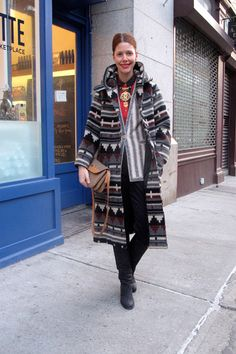 """What I'm wearing: """"Another vintage mash-up: satin Céline pants, Ungaro bouclé blazer, thrifted plaid button-down, giant medallion necklace, also thrifted, blanket coat from eBay, and an old Gucci shoulder bag. The Acne riding boots are the only part that's new."""""""