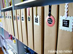 Scrapbooking Room - her organization in this room is great.  Love the little tags for her magazine holders but not sure I'd cover my holders in paper.