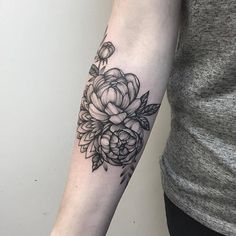 Black Ink Peony Flower Tattoo On Right Forearm