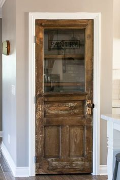 Need a pretty pantry door. Vintage farmhouse door repurposed as a pantry door - by Rafterhouse Vintage Farmhouse, Farmhouse Style, Farmhouse Door, Farmhouse Kitchens, Farmhouse Furniture, Furniture Plans, Kids Furniture, Furniture Dolly, Furniture Assembly
