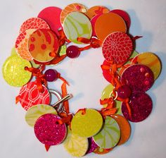 Vitamin C... A Daily Dose of Creativity: Paper Punch Charm Bracelet -- Create a light weight fun bracelet using paper. This example from Take Your Vitamin C was created using water color paper but I imagine making one using scrapbooking paper. What a great idea for using up all your scrap paper you have been saving.