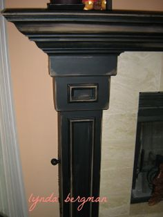 Lynda Bergman Decorative Artisan: PAINTING GAYLE'S MANTEL FROM PICLKLED, WHITE WASHED OAK TO BLACK DISTRESSED Black Fireplace Surround, Painted Fireplace Mantels, Painted Mantle, Distressed Fireplace, Paint Fireplace, Faux Fireplace, Fireplace Remodel, Fireplace Surrounds, Fireplace Design