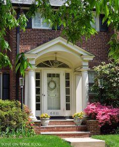small portico over entry brick - Google Search Portico Entry, Front Porch Columns, Front Porch Design, Front Entrances, Colonial Front Door, Colonial Exterior, House Front Door, Exterior Doors, Front Doors