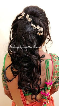 Romantic bridal updo by Vejetha for Swank. Bridal hairstyle. Curls. Hair accessory. Bridal silk saree. Saree blouse design. South Indian bride. Bridal updo.