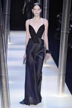 A model walks the runway at the Giorgio Armani Prive Spring Summer 2015 fashion show during Paris Haute Couture Fashion Week on January 27, 2015 in Paris, France.