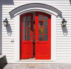 I love the look of this front door with the curve over it. Is there a better color than red? Hmmmm?