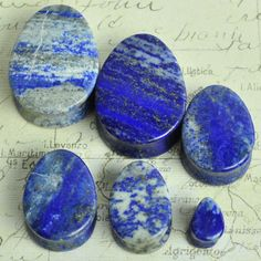 Hey, I found this really awesome Etsy listing at https://www.etsy.com/listing/220657813/pair-of-lapis-lazuli-teardrop-ear-plugs