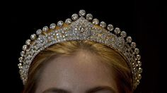 Mary, Duchess of Roxburghe's art deco tiara by Cartier, modeled by Sotheby's employee, lycky woman.