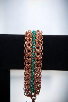 Valentine's Day Sale:  Copper Double-Strand Cylon Cuff Bracelet with Bright Green Silvered Enameled Copper Connector Rings. $115.00, via Etsy.