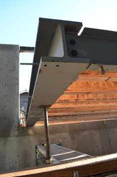 steel-i-beam-cantilevered-over-concrete-wall