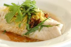 Steamed Fish Cantonese Style: light soy sauce, ginger, cilantro and green onions