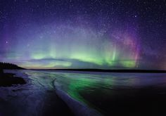 The stunning Aurora Borealis over Slave River, Northwest Territories, Canada.