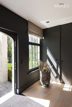 Fully intend to paint all the walls, trim, and windows a dark color like this in one room of the new house! I love light walls accented by some drama in a few select spaces. Entry Nook, Entry Foyer, Vestibule, Interior Architecture, Interior And Exterior, Interior Design, Inside A House, Living Room Remodel, My Dream Home