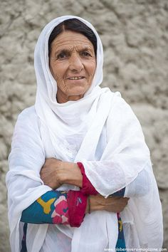An older lady in Gulmit Village in the Upper Hunza Valley north of the Attabad Lake, Hunza Vallay, PAKISTAN