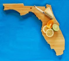 AHeirloom's Florida State Cutting Board by AHeirloom on Etsy, $40.00. Hubby wants me to order this one.  :)