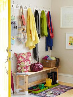 Dedicated Drop Zone: By-the-door storage makes it easy to catch clutter the moment it enters your home. Even slim hallways can accommodate a bevy of small solutions just inside the door to gather everyday essentials.