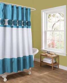 Seascape shower curtain in faux silk has gathered fabric detail. - Includes: 1…