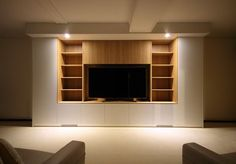This elegant entertainment unit, in a velvet white finish compliments the feature timber display shelving. This bespoke unit spans metres and integrates ducted heating through the base of the unit.What a clever solution in a difficult space. Cabinet Shelving, Display Shelves, Tv Cabinets, White Cabinets, Walk In Wardrobe Design, Timber Shelves, Entertainment Units, Bed Wall, Wall Units