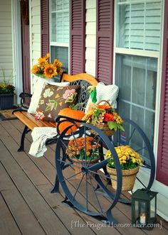 fall front porch, curb appeal, porches, seasonal holiday decor, enjoyed decorating with my new yard sale find a huge iron wagon wheel planter Porch Handrails, Front Porch Makeover, Traditional Porch, Small Front Porches, Porch Welcome Sign, Balcony Design, Roof Design, Reno, Porch Decorating