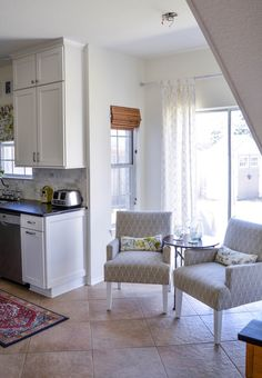 turn your too small breakfast nook into a sitting area in the kitchen via here-lately.com