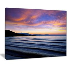DesignArt Blue Dramatic Sky over Layered Waves Seashore Photographic Print on Wrapped Canvas Size: