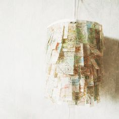 City Lamp Map Art. Add mod podge to map paper to make it stronger and more transparent. Use the treated map paper to wrap up the lampshade. Place energy saving bulbs in the lamp to finish off this unique and lush lamp which is perfect for dining table lighting.