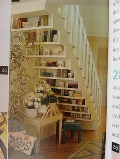 shelves under stairs = great reading nook