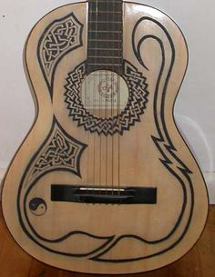 Etched Celtic guitar with a steel ruler