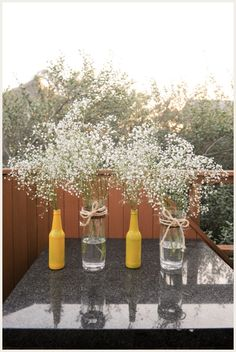 spraypainted bottles with baby's breath