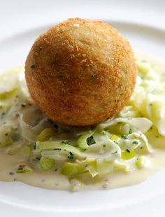 This smoked haddock fish cake recipe from Dominic Chapman is served with a sumptuous portion of creamed leeks in this recipe.
