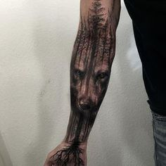 wolf face and forest tattoo sleeve