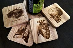 A set of wooden anatomy coasters. | 27 Infectiously Cool Gifts For Medical Nerds