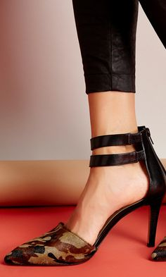 Genuine leather mid heel pump with double ankle buckle, pointed toe and easy back zipper.