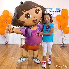 Photo ops with a life-size Dora = supercool Dora birthday party activity idea! Vamanos to the Dora Party Ideas Guide for more awesome tips!