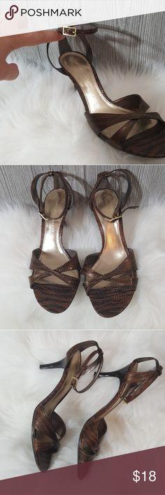 8m Antonio melani zebra print brown heel Like brand new zebra print brown heel with a snake like texture by Antonio melani size 8 m. Warren only maybe once or twice. Really no cosmetic wear ANTONIO MELANI Shoes Heels