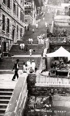Ladder St in Hong Kong.The railings closest to the bottom is where YMCA is today/Bridges St. , Ladder St in Hong Kong.The railings closest to the underside is the place YMCA is as we speak/Bridges St. Ladder St in Hong Kong. History Of Hong Kong, Fan Ho, British Hong Kong, Hongkong, China Hong Kong, Cultural Architecture, Modern Metropolis, World Cities, Urban Life